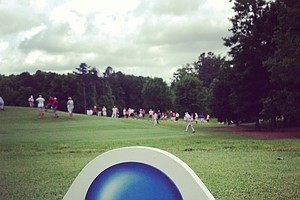 Crowds make their way down the fairway during the semifinals of match play at the 2013 NCAA Championship at Capital City Club Crabapple Course.