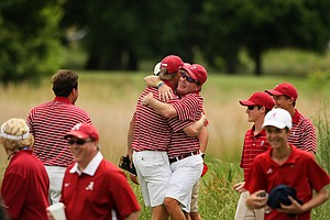 Alabama head coach Jay Seawell hugs Trey Mullinax who won the second match at the 2013 NCAA Championship at Capital City Club Crabapple Course.