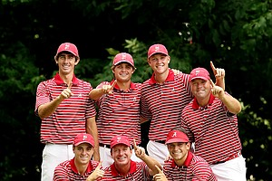 (Back Row) Alabama's Scott Strohmeyer, Bobby Wyatt, Trey Mullinax, assistant coach Rob Bradley, (front row) Justin Thomas, head coach, Jay Seawell and Cory Whitsett, pose with the trophy at the 2013 NCAA Championship at Capital City Club Crabapple Course.
