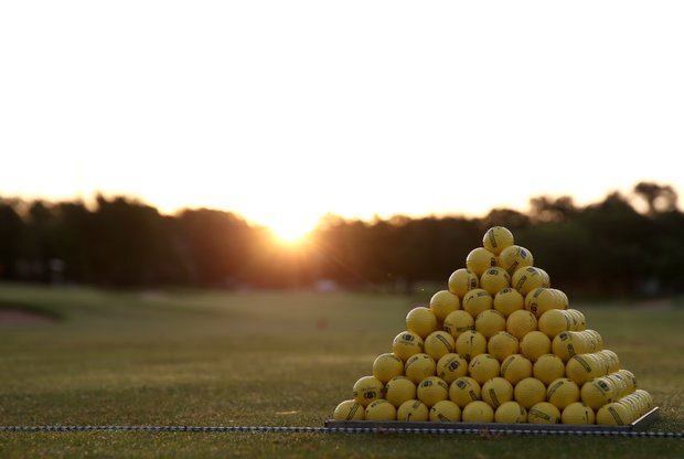 A stack of golf balls on the practice range at Lakewood Country Club.