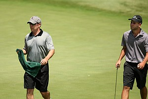 Champions Tour player John Huston caddied for his son Travis Huston during U. S. Open Sectional Qualifying at Hawks Ridge Golf Club in Ball Ground, GA.