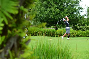 Brad Schneider tees off at the 3rd hole during the second round of U.S. Open Sectional Qualifying at the Ritz-Carlton Members Golf Club in Bradenton, Fla.