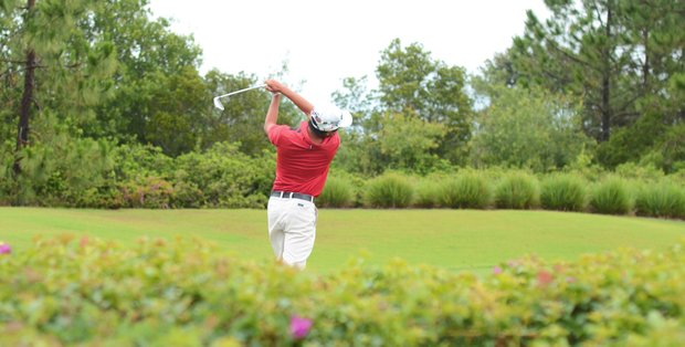 Qiwen Wong hits his tee shot at the 3rd hole during the second round of the U.S. Open Sectional qualifier at the Ritz-Carlton Members Golf Club in Bradenton, Fla.