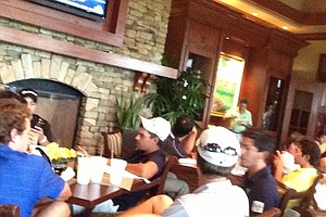 Players fill the clubhouse as weather delays sectional qualifying at Bradenton, Fla., for the 2013 U.S. Open at Merion.
