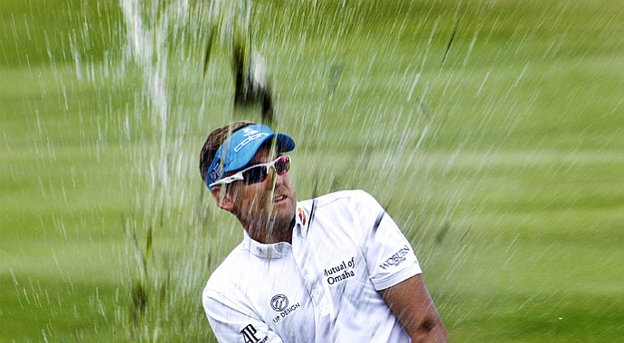 Ian Poulter hits from the water during the 2013 FedEx St. Jude Classic in Memphis, Tenn.