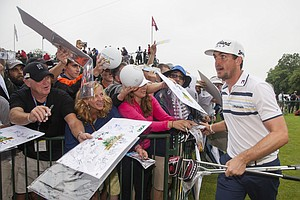Fans wait for an autograph from Keegan Bradley during a practice round at the 2013 U.S. Open at Merion Golf Club in Ardmore, Pa. on Monday, June 10, 2013.