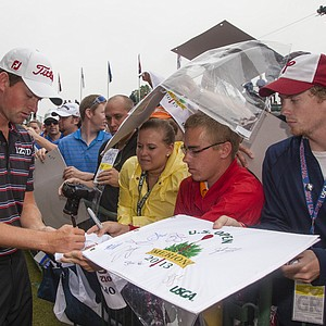 Webb Simpson signs an autograph during a practice round at the 2013 U.S. Open at Merion Golf Club in Ardmore, Pa. on Monday, June 10, 2013.