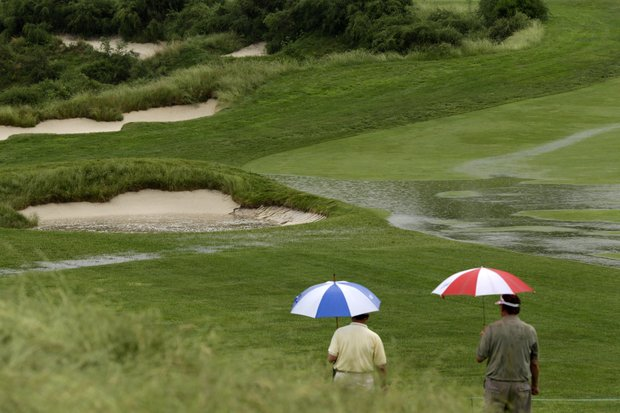 Rain struck host Merion GC, limiting Monday practice during the first day of U.S. Open week in 2013.