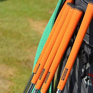 Francesco Molinari has put new, orange Pirelli grips on his irons.