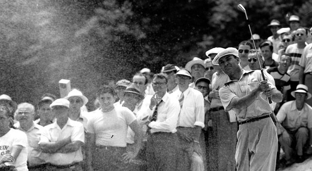 Ben Hogan blasts from the sand trap on the 12th hole during the third round of the U.S. Open Golf Tournament at Ardmore, Pa., on June 10, 1950.