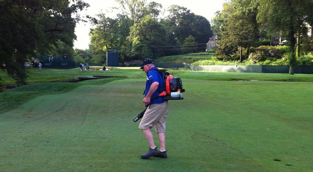 Volunteer groundskeeper Charlie Carr blow-dries the 11th fairway at Merion Golf Club on Tuesday before the U.S. Open.