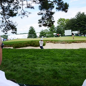 John Huh hits from a greenside bunker on the 15th green on Tuesday at Merion.