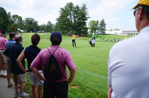 Amateur and Cal standout Michael Kim hits from the 15th fairway on Tuesday at Merion.