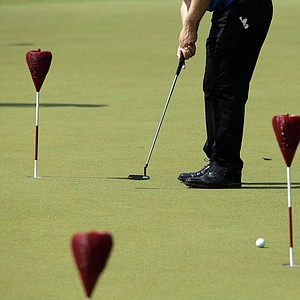 Morten Orum Madsen works on his putting as the sun came out for U.S. Open practice Tuesday at Merion GC in Ardmore, Pa.