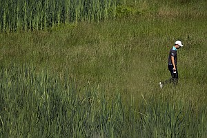 Sang Moon Bae walks the 17th hole as the sun came out for U.S. Open practice Tuesday at Merion GC in Ardmore, Pa.