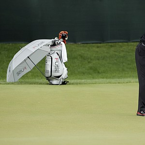 Tiger Woods works on his game as the sun came out for U.S. Open practice Tuesday at Merion GC in Ardmore, Pa.