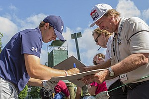 Jordan Spieth signs autographs as the sun came out Tuesday for practice at the 2013 U.S. Open at Merion GC in Ardmore, Pa.