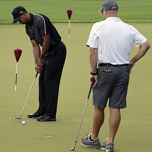 Tiger Woods works on his game with caddie Joe LaCava as the sun came out for U.S. Open practice Tuesday at Merion GC in Ardmore, Pa.