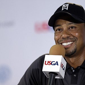 Tiger Woods speaks at a news conference as the sun came out for U.S. Open practice Tuesday at Merion GC in Ardmore, Pa.