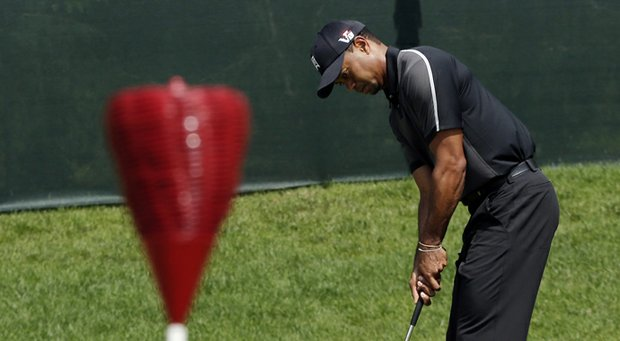 Tiger Woods practices for the 2013 U.S. Open at Merion Golf Club in Ardmore, Pa.