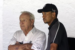 Arnold Palmer and Tiger Woods talk as the sun came out Tuesday at Merion GC for practice for the 2013 U.S. Open in Ardmore, Pa.