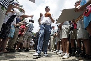 Lee Westwood signs autographs for fans after putting practice as the sun came out Tuesday at Merion GC for practice for the 2013 U.S. Open in Ardmore, Pa.