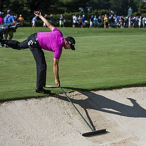 Sergio Garcia rakes a bunker on the second hole during a practice round at the 2013 U.S. Open at Merion Golf Club in Ardmore, Pa. on Wednesday, June 12, 2013.