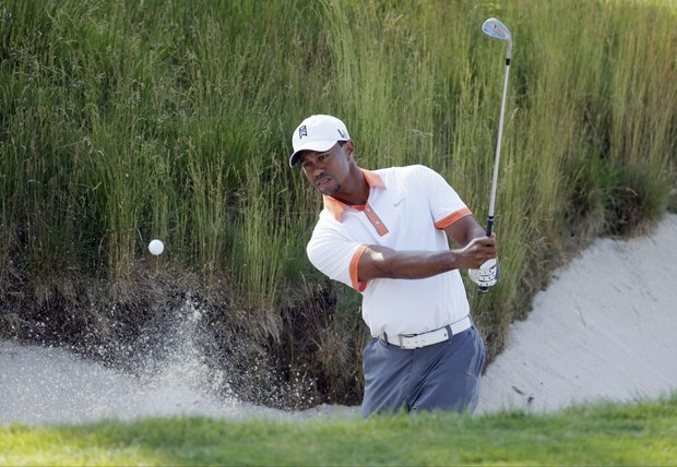 Tiger Woods hits out of a bunker on the 17th hole during a practice round for the U.S. Open.
