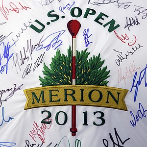Merion Golf Club's red wicker-basket pins already have become a standout among the sights during practice for the 2013 U.S. Open – including the tournament logo.