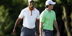 PHOTOS: Woods, McIlroy play practice round