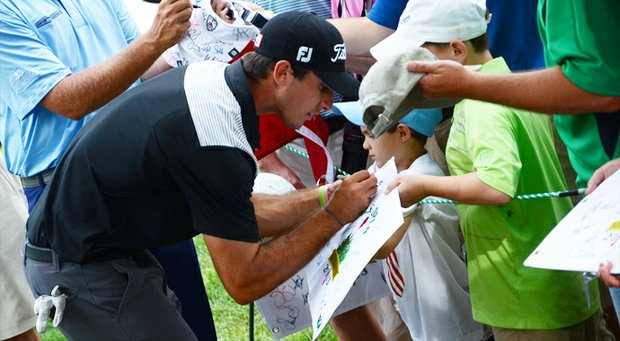 Max Homa stops to sign autographs after finishing his 13th hole in a practice round on Wednesday at the U.S. Open.