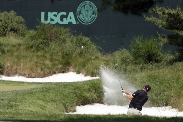 Padraig Harrington, of Ireland, hits out of a bunker on the 14th hole during practice for the U.S. Open at Merion Golf Club, Wednesday, June 12, 2013, in Ardmore, Pa.