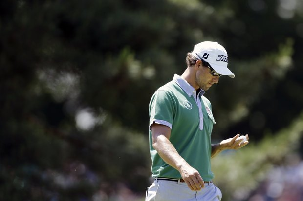 Adam Scott walks to the third tee box during practice for the U.S. Open at Merion Golf Club, Wednesday, June 12, 2013, in Ardmore, Pa.