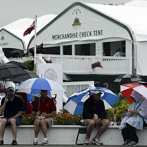Spectators wait out a weather delay during the first round of the U.S. Open golf tournament at Merion Golf Club, Thursday, June 13, 2013, in Ardmore, Pa.