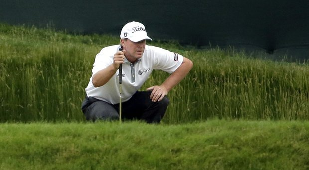 Steve Stricker lines up a putt on the 13th hole during the first round of the U.S. Open.