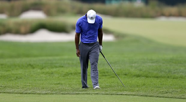Tiger Woods reacts after a shot on the second hole during the first round of the U.S. Open.