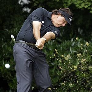 Phil Mickelson tees off on the 11th hole during the first round of the U.S. Open golf tournament at Merion Golf Club, Thursday, June 13, 2013, in Ardmore, Pa.