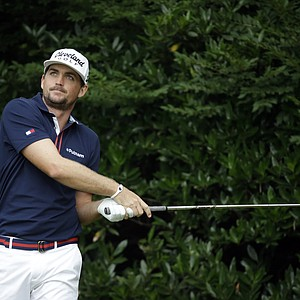 Keegan Bradley watches his tee shot on the 11th hole during the first round of the U.S. Open golf tournament at Merion Golf Club, Thursday, June 13, 2013, in Ardmore, Pa.