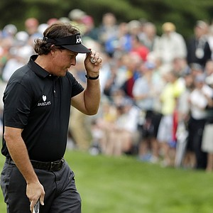 Phil Mickelson tips his hat on the 12th green during the first round of the U.S. Open golf tournament at Merion Golf Club, Thursday, June 13, 2013, in Ardmore, Pa.