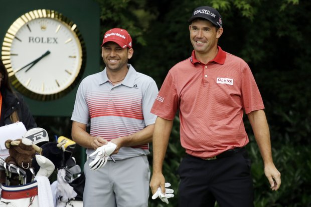 Padraig Harrington, right, and Sergio Garcia laugh before teeing off on the 11th hole during the first round of the U.S. Open golf tournament at Merion Golf Club, Thursday, June 13, 2013, in Ardmore, Pa.
