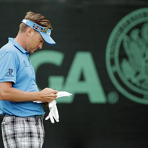 Ian Poulter looks at his notes after putting on the 13th hole during the first round of the U.S. Open golf tournament at Merion Golf Club, Thursday, June 13, 2013, in Ardmore, Pa.