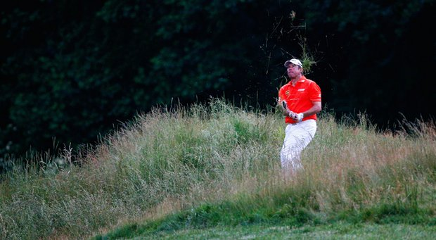 Lee Westwood hits out of the grass on the 12th hole during the first round at the 2013 U.S. Open at Merion Golf Club.