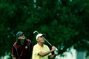 Tagg and Brett Bowman watch their shot at No. 17 during the Golfweek Father & Son Open at Reunion Resort.