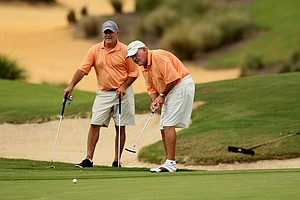 Skip and Patrick Jaehne watch thier putt at No. 17 during the Golfweek Father & Son Open at Reunion Resort.
