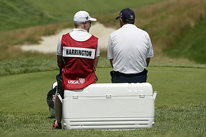 Padraig Harrington and his caddie during the third round of the 2013 U.S. Open at Merion Golf Club.