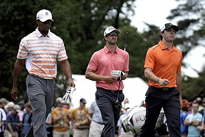 Tiger Woods, Adam Scott and Rory McIlroy during the second round of the 2013 U.S. Open at Merion Golf Club.