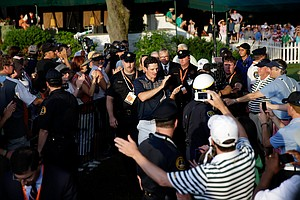 Justin Rose is congratulated as he walks to the trophy presentation after winning the U.S. Open at Merion Golf Club.