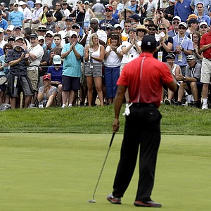 Spectators applaud Tiger Woods on the fifth green during the fourth round of the U.S. Open.