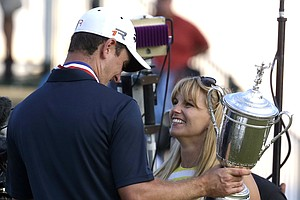 Justin Rose and his wife after his U.S. Open win in 2013 at Merion Golf Club.