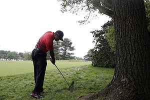Tiger Woods hits down the second hole during the fourth round of the U.S. Open.